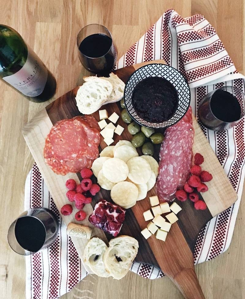 How to make a charcuterie board your guests will love! This meat and cheese platter is the perfect idea for your holiday party. A winter charcuterie is an amazing appetizer for your guests. Check out how to make a charcuterie board display with the best wine pairing!